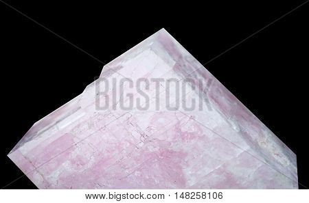 Gypsum is a soft sulfate mineral composed of calcium sulfate dihydrate on black background