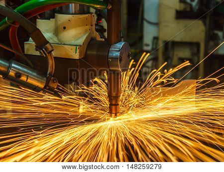 Spot welding machine Industrial automotive part in cars factory with fire spark