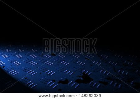 blue diamond plate with spot lighting and drop of paint on black shadow background. 3d illustration.