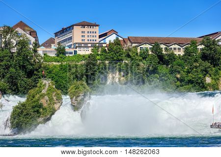 The Rhine Falls waterfall on the Rhine river in Switzerland in summertime.