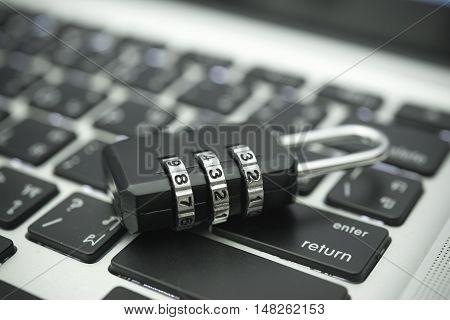 Closeup padlock on computer keyboard for concept data lock security