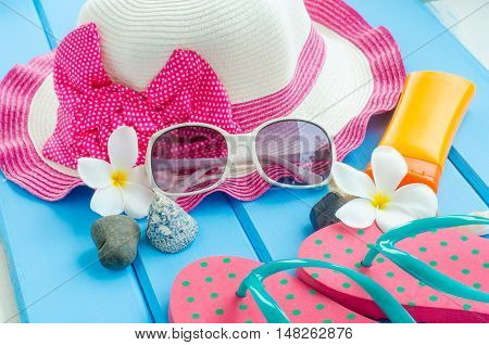 Accessories costume with travel for summer on blue wooden floor