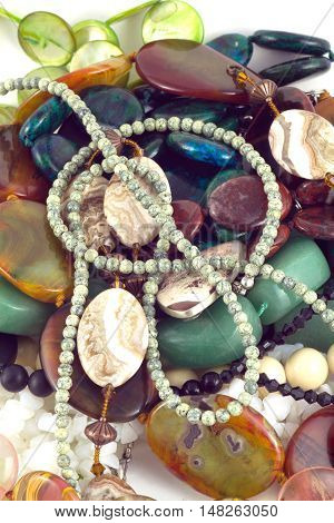 Color Semi-precious Gems fashion jewelry isolated on white vertical view closeup