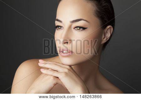 natural look woman beauty portrait, studio background