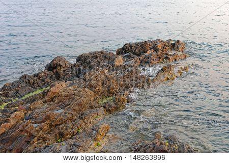 Stones and Rocky Shore at Mediterranean Sea