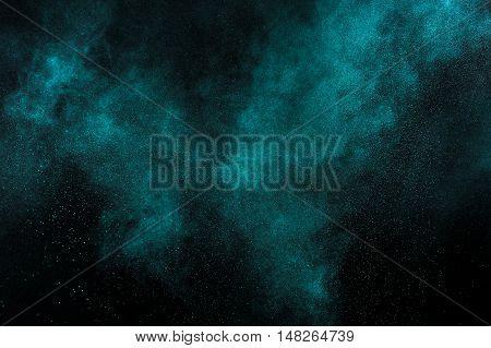 Aquamarine Powder Explosion On Black Background.