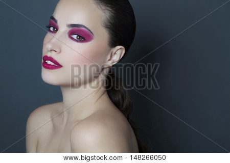 beautiful woman portrait with attractive intensive makeup