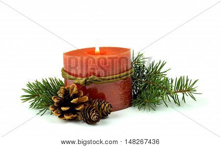 Christmas composition: Burning candle fir branches cones. / Isolation on a white background /. In anticipation of the holiday. Simple rustic style the gifts of nature for the decoration.