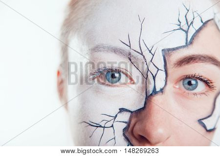 Girl with Halloween face art on white background