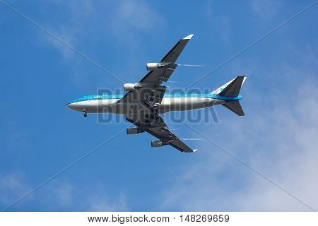 Amsterdam Netherlands - July 03 2016: The aircraft of KLM company flying over the city of Amsterdam