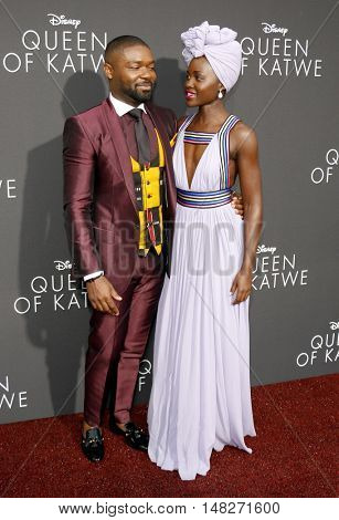 David Oyelowo and Lupita Nyong'o at the Los Angeles premiere of 'Queen Of Katwe' held at the El Capitan Theatre in Hollywood, USA on September 20, 2016.