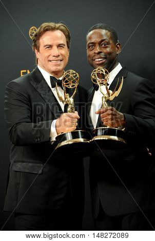 John Travolta and Sterling K. Brown at the 68th Annual Primetime Emmy Awards - Press Room held at the Microsoft Theater in Los Angeles, USA on September 18, 2016.