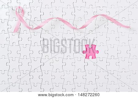 Pink ribbon and the puzzle pieces breast cancer.