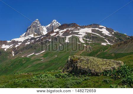 Two peaks of Mount Ushba. Main Caucasian Ridge. Georgia