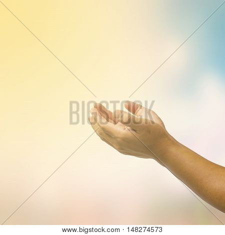 open hand on blurred abstract nature background - concept help
