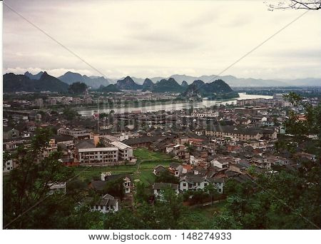 A view of the city of Guilin, China, from the top of a hill, circa 1987.