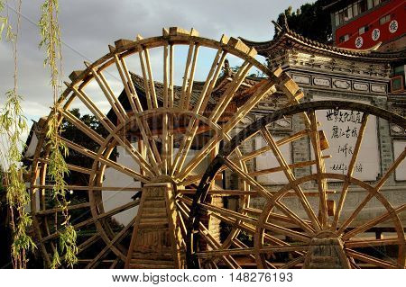 Lijang China - April 21 2006: Two landmark wooden water wheels in historic Si Feng Square