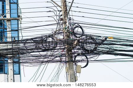 Wire tangled on a pole high voltage dangerous concept.