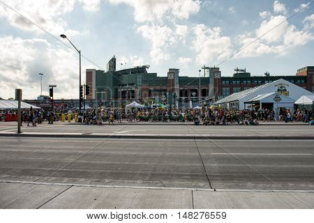 Green Bay WI - 31 July 2016: Fans of the Green Bay Packers are outside Lambeau Field tailgating.