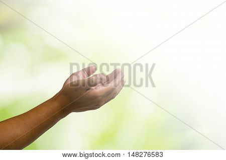 open hands on blurred abstract nature background - concept for help