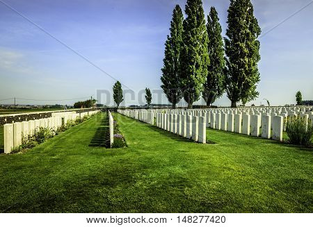 FLANDERS FIELDS, BELGIUM - MAY 12, 2016: Rows of headstones in a cemetery in west Belgium holding the remains of the casualties of WW1. The 100th anniversary of the end of the War will be marked in 2018.