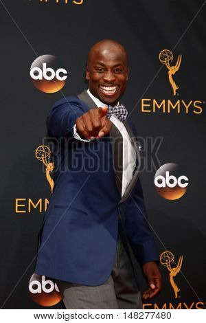 LOS ANGELES - SEP 18:  Akbar Gbaja-Biamila at the 2016 Primetime Emmy Awards - Arrivals at the Microsoft Theater on September 18, 2016 in Los Angeles, CA