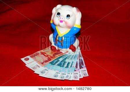 Pig On Money, On A Red Background