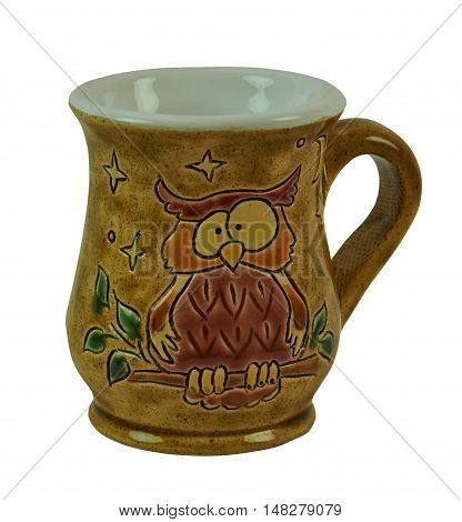 Mugs - pottery handmade from clay. Decorated with patterned owls. Isolated on a white background