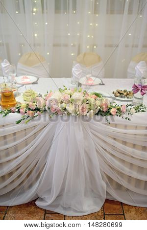 Beautiful Wedding Restaurant For Marriage. White Decor For Bride And Groom. Colorful Decoration For