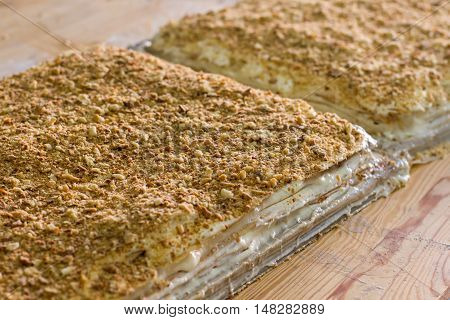 Big layered dessert. Biscuit crumbs and cream. Traditional recipe of napoleon cake. Fresh puff dough.