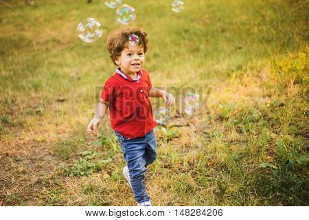 Little Boy Playing In The Park