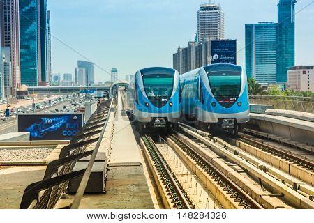 Dubai, United Arab Emirates - May 1, 2013: Dubai Metro the worlds longest fully automated metro network. Dubai Metro train along the Red Line.