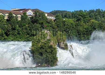 The Rhine Falls in summertime. The Rhine Falls is the largest plain waterfall in Europe, located on the Rhine river in Switzerland.