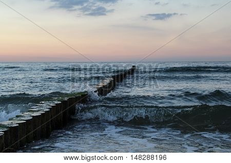 Groynes in the Baltic Sea in evening light