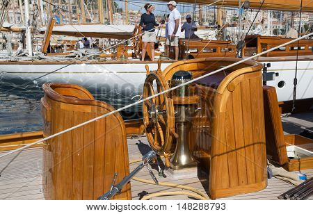 CANNES, FRANCE - 19 SEPTEMBER, 2016: Steering wheel of classic Sailboat anchored in Vieux Port (old port) during the Sailing regatta