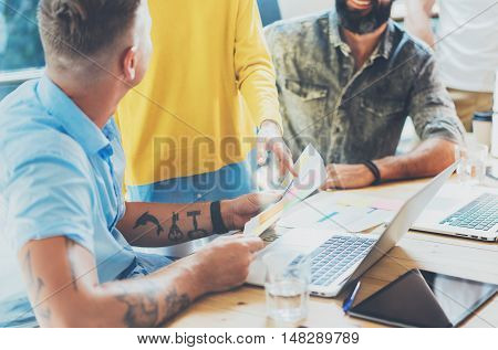 Coworkers Team Brainstorming During Work Process Modern Loft. Business Startup Concept.Woman Discussing Finance Report Colleagues.Young People Working Laptop Gadget Wood Table Desk.Blurred Background