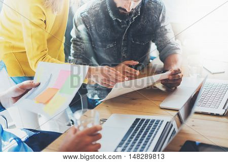 Coworkers Team Brainstorming During Work Process Modern Loft. Business Startup.Teamwork Concept.Woman Discussing Finance Report Colleagues.Young People Working Laptop Gadget Wood Table Desk.Blurred