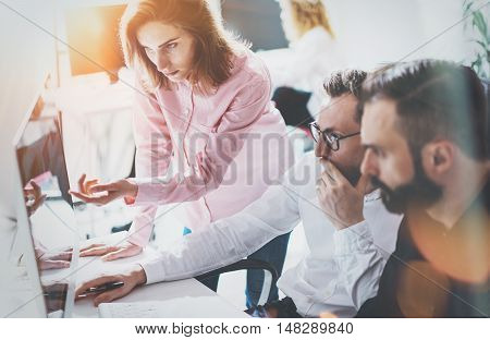 Coworkers Business Meeting Process Sunny Modern Office.Teamwork Concept.Group Young People Discussing Together Startup Idea.Businessman Team Working Online Project Desktop.Blurred Background