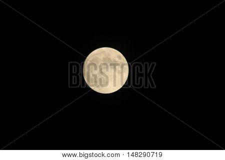 Full moon on a dark black background