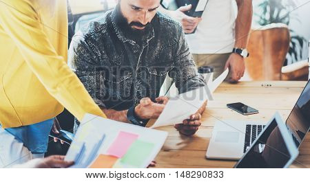 Teamwork Concept.Coworkers Team Brainstorming During Work Process Modern Loft Office.Business Startup Project.Woman Discussing Finance Report Colleagues.Young People Working Gadgets Wood Desk
