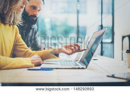 Closeup Two Modern Coworker Discussing Together During Working Process.Young Business Team Meeting Concept.People Discussion Startup Project Office.Bearded Hipster Work Laptop Wood Desk Table.Blurred