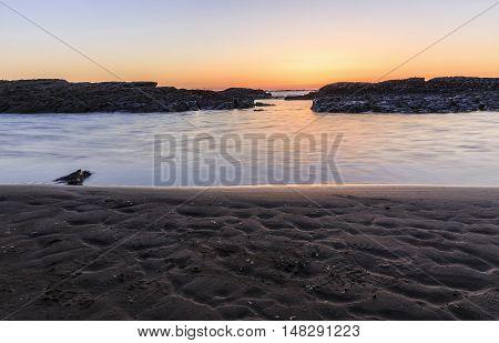 Rocks on the coast of the Caspian Sea near Baku at sunrise.Azerbaijan