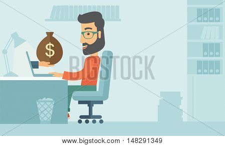 Businessman with beard wearing glasses sitting infront of his table working at a laptop searching and browsing with bag of money on hand inside the office. Business concept. A contemporary style with