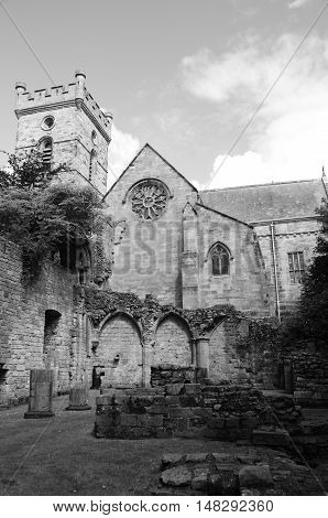 A view of the ruins of Culross abbey and the church behind it