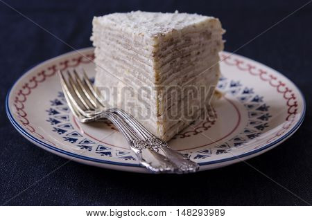 Pancake cake with cream and sour cream for breakfast