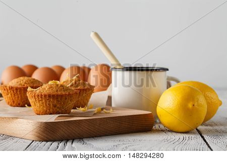 Mini Lemon Cakes On A Plate With Charger And Fork