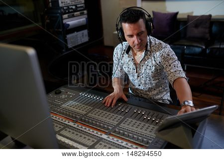Music composer using digital tablet when working in studio