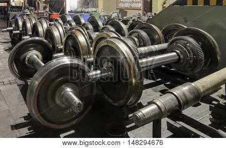 Many wheelset standing on the floor. Details of the train wheel