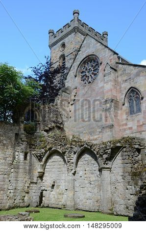 A view of the church in Culross towering above the ruins of the medieval abbey