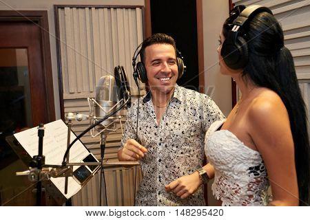 Duet recording song in professional music studio